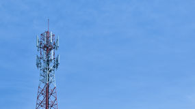 Signal tower with blue sky. Signal tower with blue sky,Communication technology  for the connection around the world Royalty Free Stock Photos