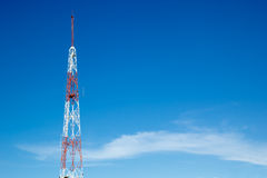 Signal tower on blue sky Royalty Free Stock Photography