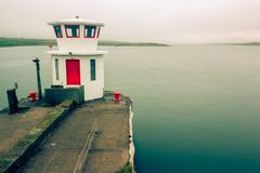 The Signal Tower. On the bridge connecting Portmagee to Valentia Island. Taken on a misty day Stock Photo