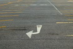 Arrow Turn Right Sign on The Road. The Signal White Turn Right Sign Arrow Painted On on The Road Surface royalty free stock image