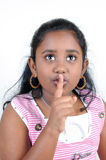 Signaling for silence. A pretty girl signaling for silence with her finger Stock Image
