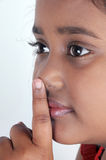 Signaling for silence. Indian girl signaling for silence with her finger Stock Images