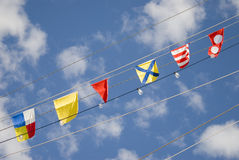 Signals flags. Nautical signal flags in the sky Royalty Free Stock Photography