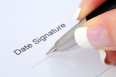 Signature. A signature on the contract Stock Image