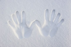 Signature. Imprint of two hands on the white sand stock photo