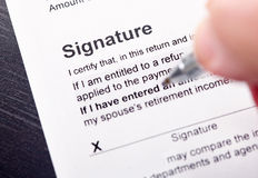 Signature. Filling and signature the Tax Form Stock Photo