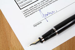 Signature. Under a business contract agreement with a fountain pen. The  is fictional Royalty Free Stock Photos