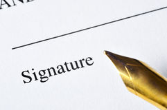 Signature. A document ready to be signed, with a pen by the side Stock Photos