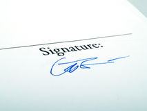 Signature. A simple signature written with a blue pen Stock Image