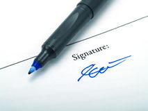 Signature. A signature and a blue pen Stock Photos