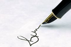 Signature. On watermarked textured paper using a gold nibbed fountain pen. Focal point is on the text Stock Photos