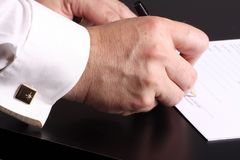Signature. Close-up of a men hand signing a contrat stock photos