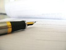 Signature. Pen with contract ready to be signed Stock Photo