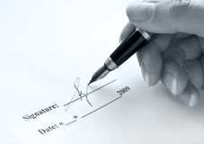 Signature. Female hand holding ink pen Stock Photography