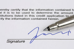 Signature. Consumer credit application - fictional signature with blue ink Stock Photo