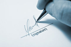 The signature. Man signing papers. The signature Royalty Free Stock Image