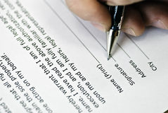 Signature on agreement Stock Photos