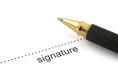 Signature and ballpoint pen Royalty Free Stock Image