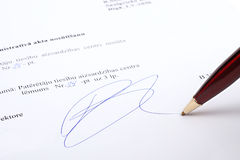 Signature on contract. Pen writes signature on contract Stock Image