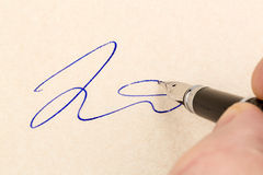 Signature on a contract Royalty Free Stock Images