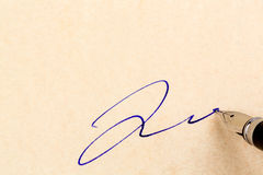 Signature on a contract Stock Photo
