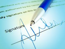 Signature, contract and a pen. Signature on a business contract Stock Image