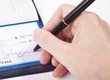 Signature d'un chèque Images stock