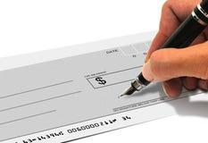 Signature d'un chèque Photographie stock libre de droits