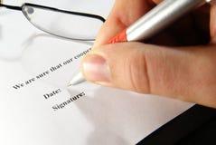 Signature on document Stock Photos