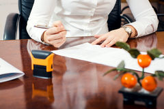 Signature document. Businesswoman signature document, working at her office Royalty Free Stock Photo