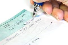 Signature du chèque Photographie stock libre de droits