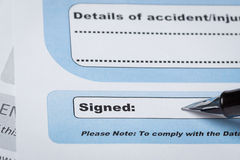 Signature field on document with pen and signed here; document i Stock Image