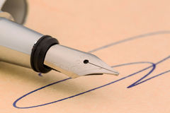 Signature and fountain pen Stock Images