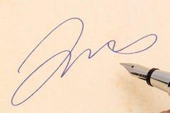 Signature and fountain pen Stock Photo