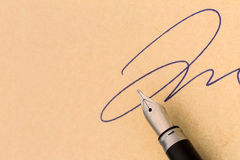 Signature and fountain pen Royalty Free Stock Photos
