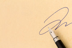 Signature and fountain pen Royalty Free Stock Photo