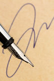 Signature and fountain pen royalty free stock image