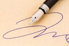 Signature and fountain pen Stock Photos