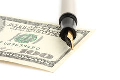 Signature on hundred dollar banknote and pen Royalty Free Stock Photos