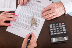 Signature of a real estate contract. Real estate contract signed (random english dummy text used Royalty Free Stock Photo