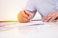 Contract. Signature under contract hands macro shot stock image