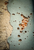 Signature of war. Remnants of building facade heavily damaged by grenade during war in Croatia Stock Photography