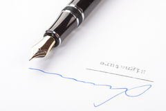 Signature on white paper Royalty Free Stock Image