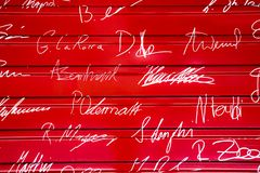 Signatures on Red Metal Background - Engelberg, Switzerland stock photo