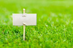Signboard. Empty signboard on green grass royalty free stock photos