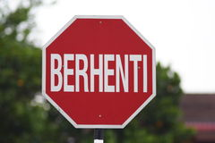 Signboard. At road in malaysia,'BERHENTI' it mean 'STOP Stock Photos