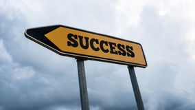 Signboard and arrow with the word - Success Royalty Free Stock Photo