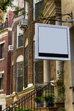Signboard. Blank signboard in front of ancient manhattan house Stock Photos