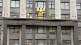 Signboard on building of State Duma and emblem of Russia in Moscow city, close-up view. Russian inscription stock video footage