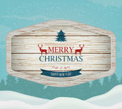 Signboard with Christmas greeting against a winter landscape. Merry Christmas and Happy New Year wishes. Vector Royalty Free Stock Photography